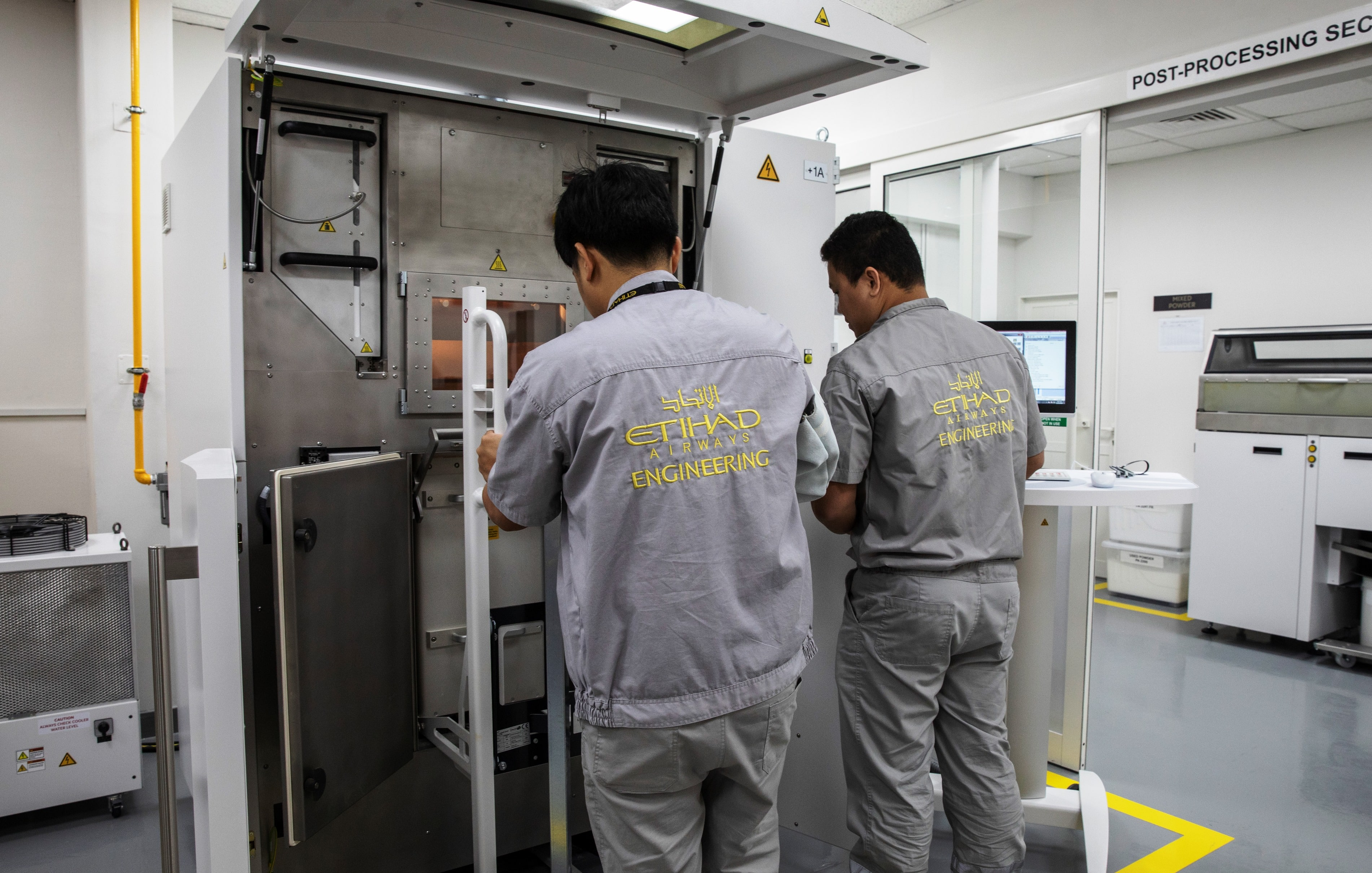 Etihad Engineering engineers at work using the pioneering EOS Additive Manufacturing 3D Printer which is now located at Etihad Engineering's facility located in Abu Dhabi. (Source: Etihad Aviation Group)